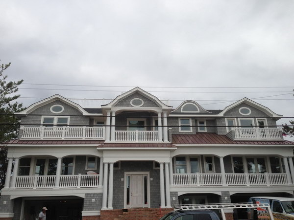 coastal-roofing-oceanfront-brant-beach-vinyl-railings-01